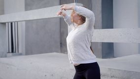 Flexible girl dancing jazz modern outdoor in summer, passionate artist. Happy young girl in grey sweatshirt performing in city, lonely dancer stock video