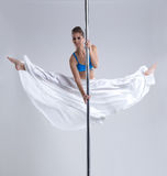 Flexible girl doing gymnastic split on pylon Royalty Free Stock Photo