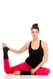 Flexible girl doing stretching pilates exercise Royalty Free Stock Photos