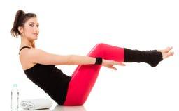 Flexible girl doing stretching pilates exercise Stock Photo