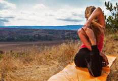 Flexible girl make yoga exercise in mountain Royalty Free Stock Image