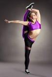 Flexible girl posing in vertical splits Stock Photo