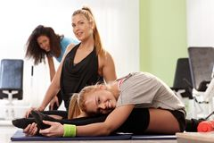 Flexible girls exercising at gym Stock Images