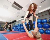 Flexible girls in fitness studio Stock Photography