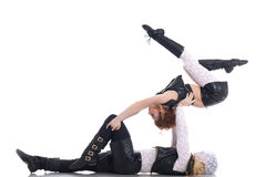 Flexible go-go dancers posing in acrobatic pose Royalty Free Stock Photo