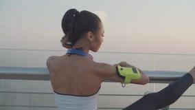 Flexible woman jogger stretching legs at daybreak
