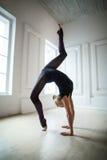 Flexible gymnast doing exercise Stock Photography