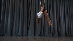Flexible gymnast performs a trick in the aerial hoop stock footage