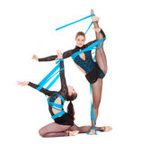 Flexible gymnasts dancing Royalty Free Stock Images