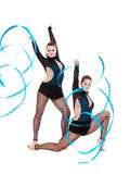 Flexible gymnasts dancing with blue ribbons Stock Image
