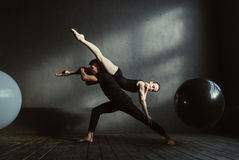 Flexible gymnasts expressing themselves during the rehearsal Royalty Free Stock Photography