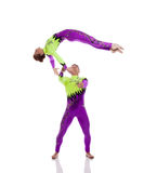 Flexible gymnasts performing tricks in studio Royalty Free Stock Photography