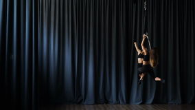 Flexible gymnasts performs a trick on the aerial hopp stock footage