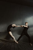 Flexible gymnasts stretching in interaction with each other Royalty Free Stock Photography