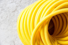 Flexible hose. Yellow protective wire construction Royalty Free Stock Photography