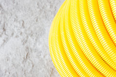 Flexible hose. Yellow protective wire construction Stock Photo