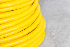 Flexible hose. Yellow protective wire construction Royalty Free Stock Photos