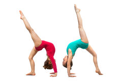Flexible kids gymnasts, isolated on white background. Sport, active lifestyle concept Royalty Free Stock Photography