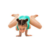Flexible little girl gymnast doing acrobatic feat on white background. Flexible little girl gymnast doing acrobatic feat, isolated on white background. Sport Stock Photography
