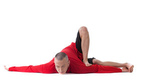 Flexible man posing in difficult yoga pose Royalty Free Stock Photo