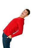 Flexible man in red clothes and jeans. On a white background Royalty Free Stock Photography