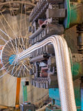 Flexible metal hose production line.Braiding machine. royalty free stock image