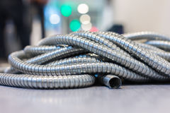 Flexible. Metal pipe on construction site Stock Photography
