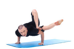 Flexible middle-aged yogi posing looking at camera Stock Photos