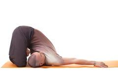 Flexible muscular man practicing yoga in studio Royalty Free Stock Photos