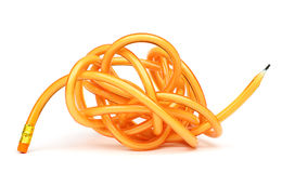 Flexible Pencil. Tangled flexible orange glitter pencil on white background Royalty Free Stock Photos