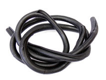 Flexible pipe. Coil of black flexible plastic corrugated pipe isolated on the white background. Cable protection Stock Photography