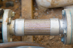 Flexible pipe and pipe connection. Royalty Free Stock Image