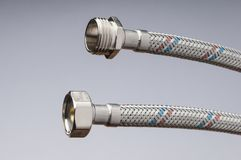Flexible piping. To connect water or gas safely stock image
