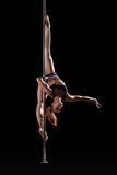 Flexible pole dancer posing on split, upside down Royalty Free Stock Photos