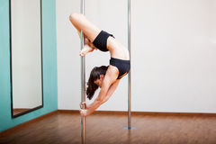 Flexible pole dancer working out Royalty Free Stock Images