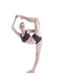 Flexible pretty blonde posing on vertical splits. Image of flexible pretty blonde posing on vertical splits Royalty Free Stock Photo