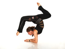 Flexible pretty woman standing on hands Stock Image