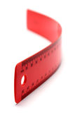 Flexible Red Ruler. On white background stock images