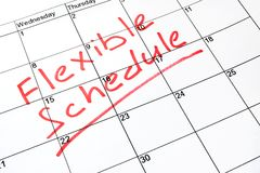 Flexible schedule. Flexible schedule written on a calendar stock image