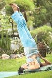 Flexible senior woman doing yoga Stock Photo