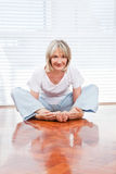 Flexible senior woman doing yoga Stock Image