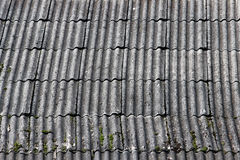 Flexible shingles of red-brown color on the house roof. stock images