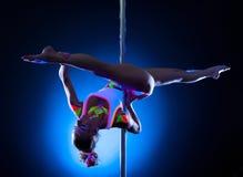 Flexible slim girl doing splits on pylon. Image of flexible slim girl doing splits on pylon Stock Image