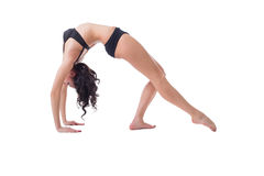 Flexible slim woman doing pilates exercise Stock Photos