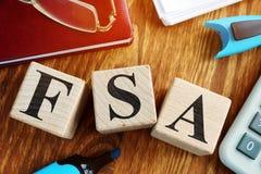 Flexible Spending Account FSA from  cubes. Flexible Spending Account FSA from wooden cubes stock photography
