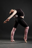 Flexible sportswoman with ball Stock Photography