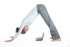 Flexible student girl working with computer royalty free stock photography