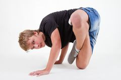Flexible Teen b-boy standing in freeze Royalty Free Stock Photo