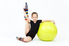 Flexible teen girl doing gymnastics exercises on fitness ball Stock Images