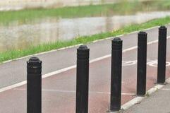 Flexible traffic bollard for bike lane. Flexible traffic bollard for bike lane near a river Royalty Free Stock Image